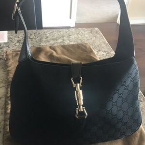 Gucci- small  monogrammed hobo-black